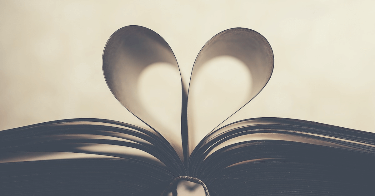 A book with two pages folded into a heart shape.