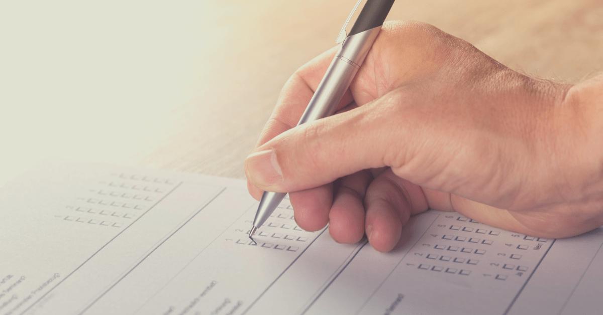 A person filling out a survey.
