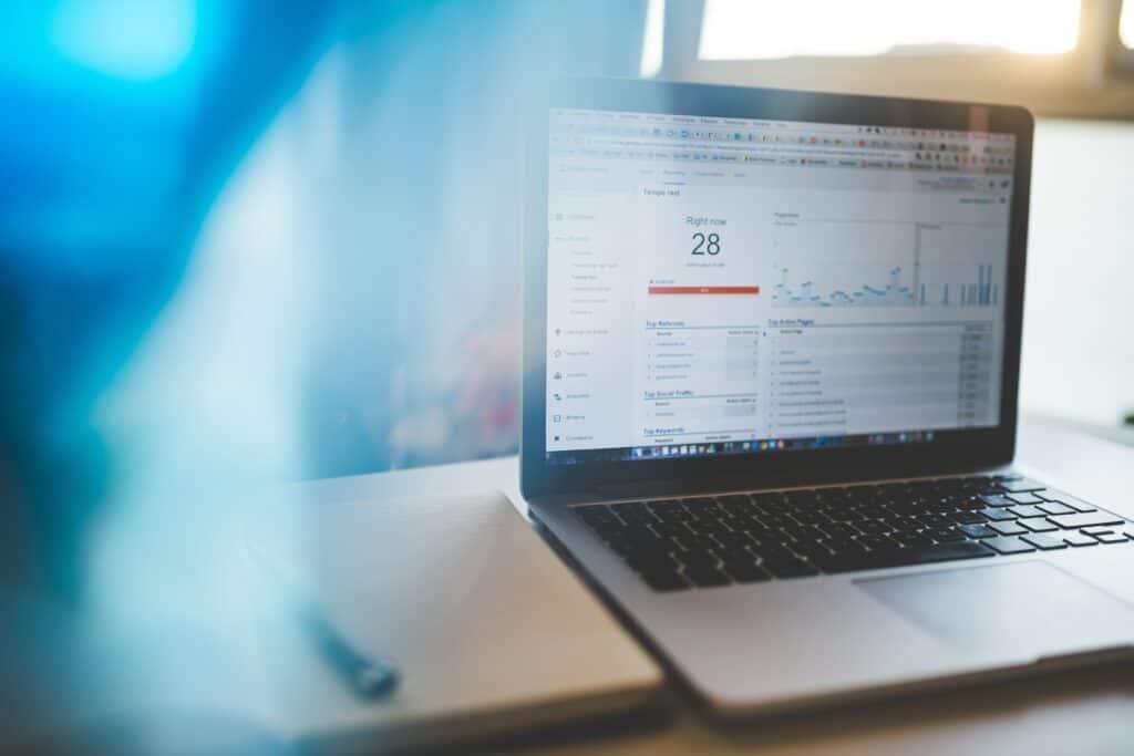 Laptop displaying metrics and KPIs
